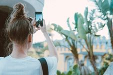 Free Photo Of A Woman Taking Picture Of Banana Trees Stock Image - 130422771