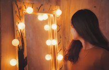 Free Woman Facing Vanity Mirror Royalty Free Stock Photo - 130422985