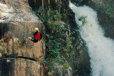 Free Woman Rocking Climbing Near Waterfalls Royalty Free Stock Photos - 130423628