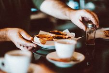 Free Selective Focus Photography Of Man Holding Bowl Of Pastry And Condiment Container Royalty Free Stock Image - 130423746