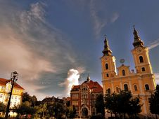 Free Cathedral Beside Building Under Blue Sky Stock Images - 130423814