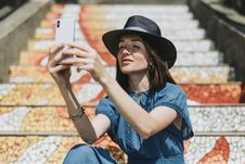 Free Woman Taking Selfie Beside Concrete Stairs Royalty Free Stock Image - 130423836