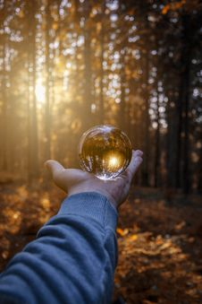 Free Person Holding Ball Glass Stock Images - 130425504