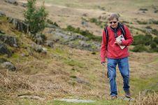 Free Man Wearing Red Jacket Walking On Pathway Royalty Free Stock Images - 130492049