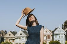 Free Woman Holding Brown Hat Near Houses Stock Photos - 130492113