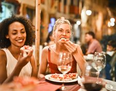 Free Woman Eating Bruschetta Stock Images - 130492214
