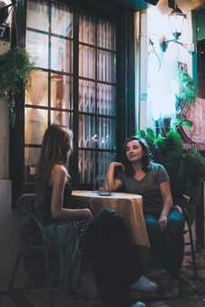 Free Two Women Sitting And Chatting Near Table Stock Image - 130492231