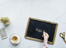 Free Flat Lay Photography Of Board Beside Teacup And Scissors Stock Photos - 130492373