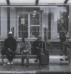 Free People Sitting On Bench At A Bus Stop Royalty Free Stock Photo - 130575085