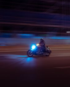 Free Person Riding On Black Motorcycle Stock Photos - 130575093
