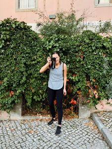Free Woman Taking Picture In Front Of Green Vine Plant Royalty Free Stock Photo - 130575285