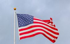 Free Usa Flag Waving On White Metal Pole Royalty Free Stock Image - 130575326
