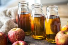 Free Close-Up Photo Of Filled Bottles Near Apples Royalty Free Stock Images - 130575399