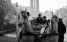 Free Grayscale Photography Of Man And Woman Riding Carriage Stock Images - 130575484