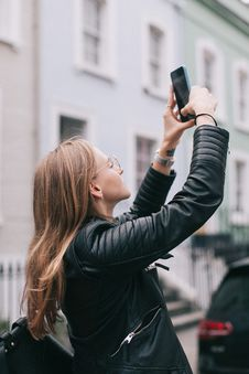 Free Photo Of Woman Taking A Photo With Her Smartphone Stock Image - 130575491