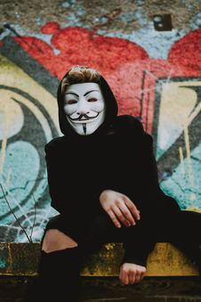Free Person Wearing Guy Fawkess Mask Stock Image - 130575561