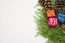 Free Three Assorted-color Present Boxes On Green Leaves Stock Photos - 130575573