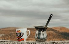 Free Multicolored M&m S Ceramic Cup Beside Gray Stainless Steel Cezve Pot Stock Photos - 130644753