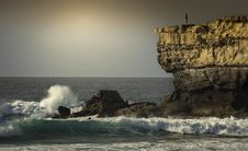 Free Person Standing On Top Of Rock Formation Surrounded By Sea Stock Images - 130644754