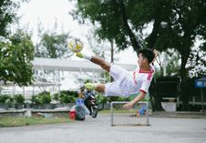 Free Time Lapse Photography Of Soccer Player Jumping Kicking Ball Stock Image - 130644861