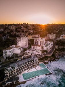 Free Birds Eye View Of Body Of Water Beside Building During Golden Hour Stock Images - 130644894