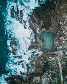 Free Natural Pool Beside Sea And Rock Formation Aerial Photography Royalty Free Stock Photography - 130706787