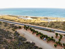 Free Aerial Shot Of Road Near Body Of Water Stock Images - 130707134