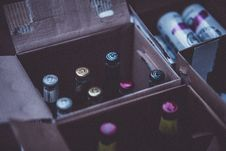 Free Glass Bottles On Boxes Close-up Photography Royalty Free Stock Photo - 130896005