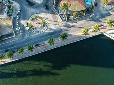 Free Aerial Photography Of Paved Road Near Body Of Water Royalty Free Stock Photo - 130896135