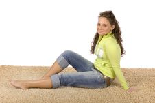 Young Woman On The Soft And Comfortable Carpet Stock Photography