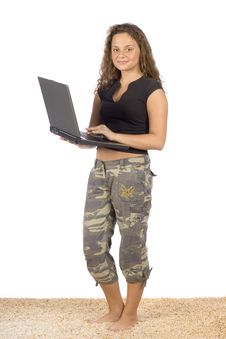 Free Female Teenager Standing On The Carpet With Laptop Royalty Free Stock Photos - 1311228