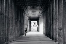 Free Grayscale Photo Of Person Walking Near Columns Royalty Free Stock Photos - 131017418