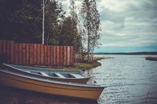 Free Two Blue And Brown Boats Near Trees Stock Photos - 131017483