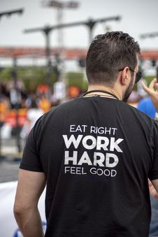 Free Person Wearing Eat Right Work Hard Feel Good-printed Shirt Royalty Free Stock Images - 131017539