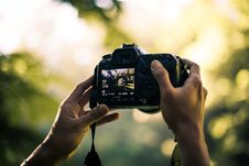 Free Person Holding Dslr Camera Selective Focal Photo Stock Image - 131108851