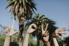 Free Four Hands Doing Love Signs Royalty Free Stock Photos - 131201138