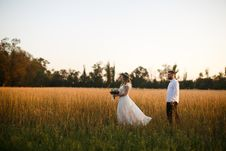 Free Groom Standing Next To Bride Holding Bouquet Of Flower On Grass Field Royalty Free Stock Photography - 131201197