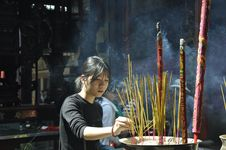 Free Woman Lighting Incense Sticks Royalty Free Stock Image - 131201236
