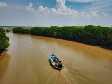 Free Group Of People Riding Boat In Middle Of River Stock Image - 131201291