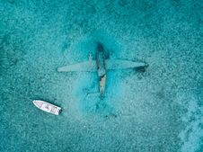 Free Top View Photo Of Boat Near Airplane Stock Photos - 131266453