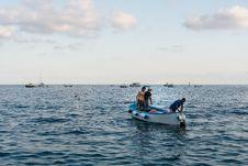 Free Three Men Standing On Boat Royalty Free Stock Photo - 131266475