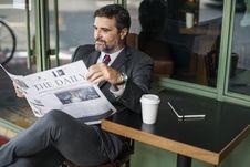 Free Photo Of Man Reading Newspaper Stock Photos - 131266533