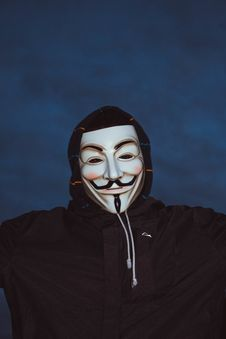 Free Person Wearing Guy Fawkes Mask And Hoodie Stock Photography - 131330092