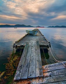 Free Blue Boat On Gray Wooden Dock Royalty Free Stock Photography - 131330167