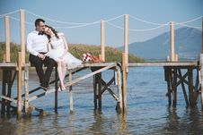 Free Photo Of Couple Sitting On Dock Royalty Free Stock Photo - 131330245