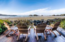Free Four Brown Adirondack Chairs On Porch Royalty Free Stock Images - 131422739