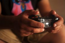 Free Person Holding Black Game Controller Royalty Free Stock Photos - 131422788