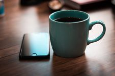 Free Close-Up Photo Of Coffee Cup Near Iphone Stock Photo - 131423070