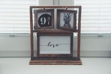 Free Brown Wooden Picture Frames Beside Window Stock Image - 131423081
