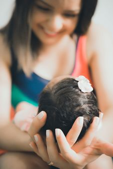 Free Close-Up Photo Of Woman Carrying Baby Stock Images - 131518564